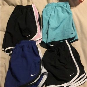 Set of 4 medium Nike running shorts